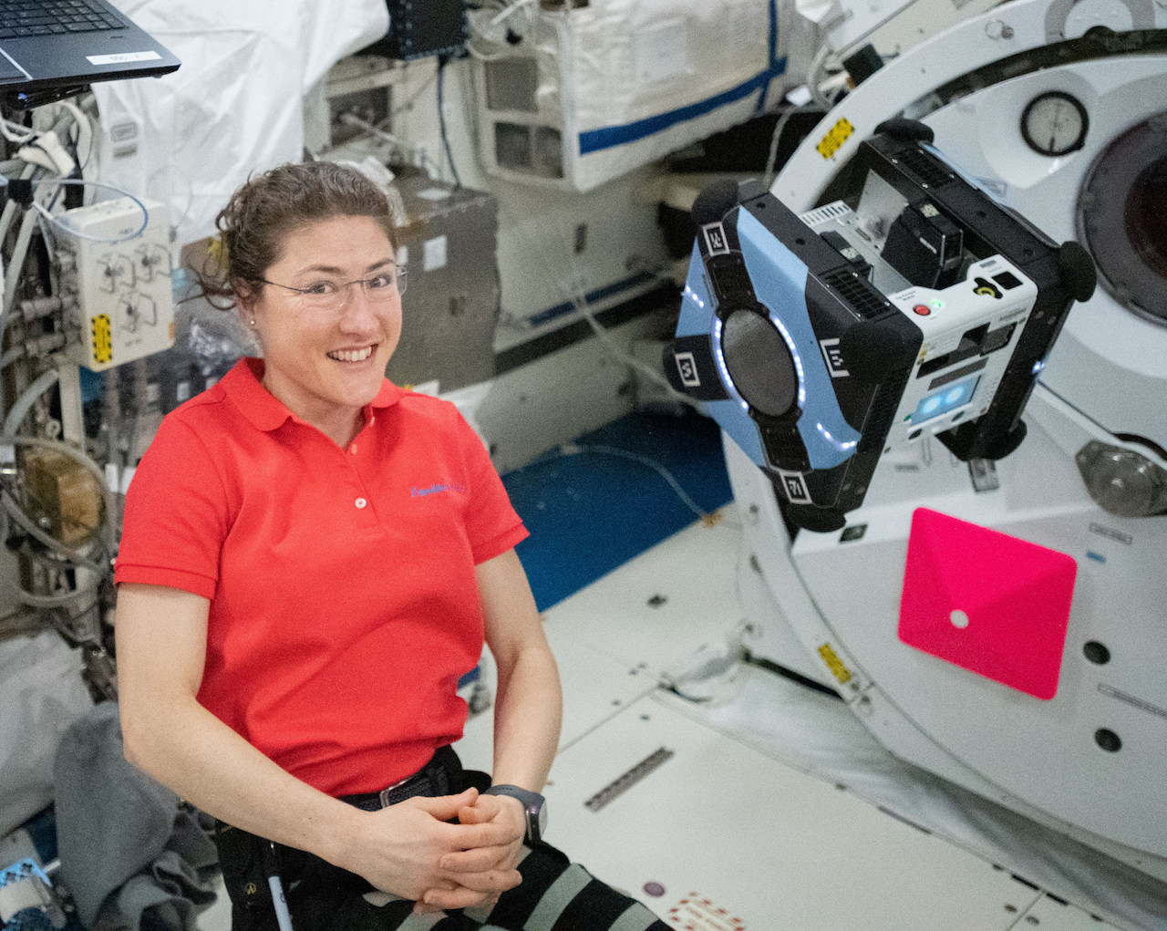 Expedition 60 Flight Engineer Christina Koch of NASA works inside Japan's Kibo laboratory module monitoring a mobility test of the free-flying Astrobee robotic assistant.
