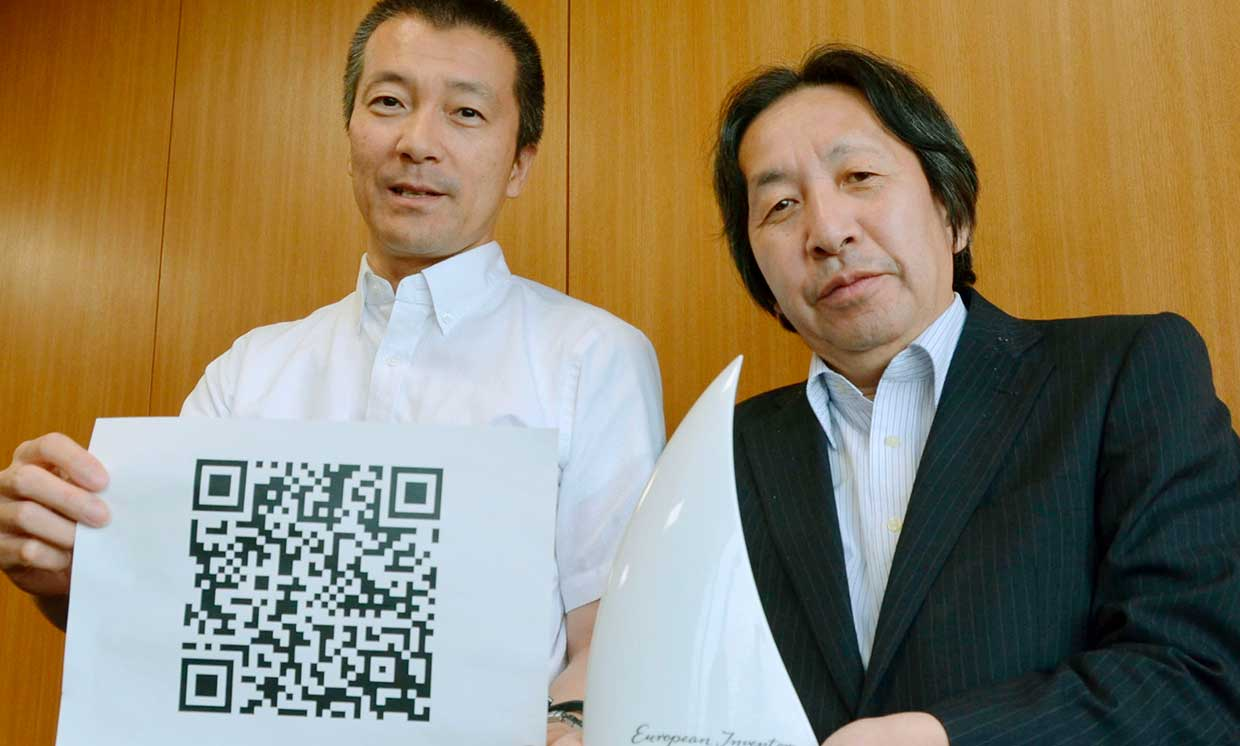 Masahiro Hara (R) of Denso Wave Inc. and Takayuki Nagaya of Toyota Central R&D Labs. Inc. show their Popular Prize awarded by the European Patent Office for their invention of the square