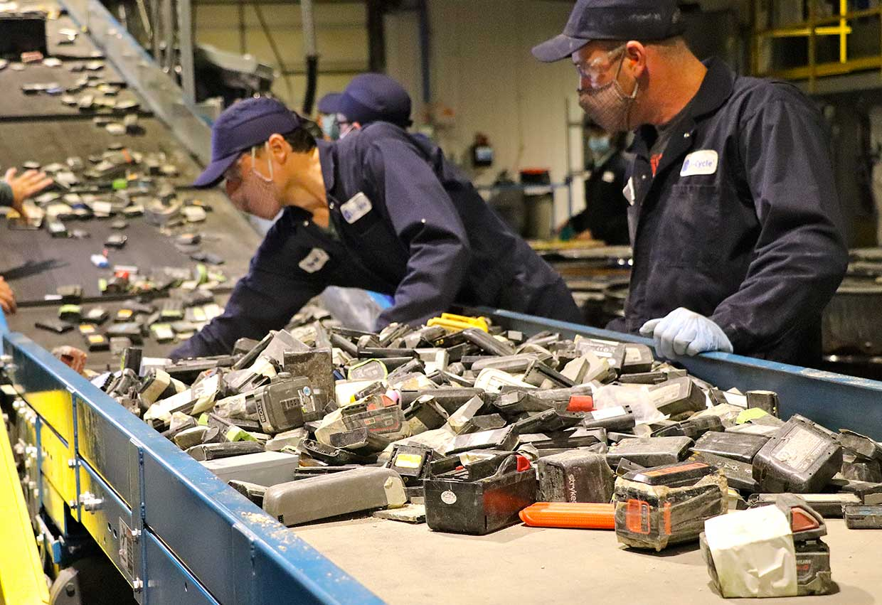 Workers sort lithium-ion batteries at Li-Cycle's recycling facility near Toronto.