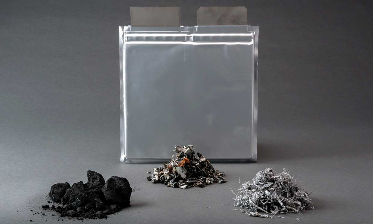 Photo of a silver battery image and 3 piles of materials.