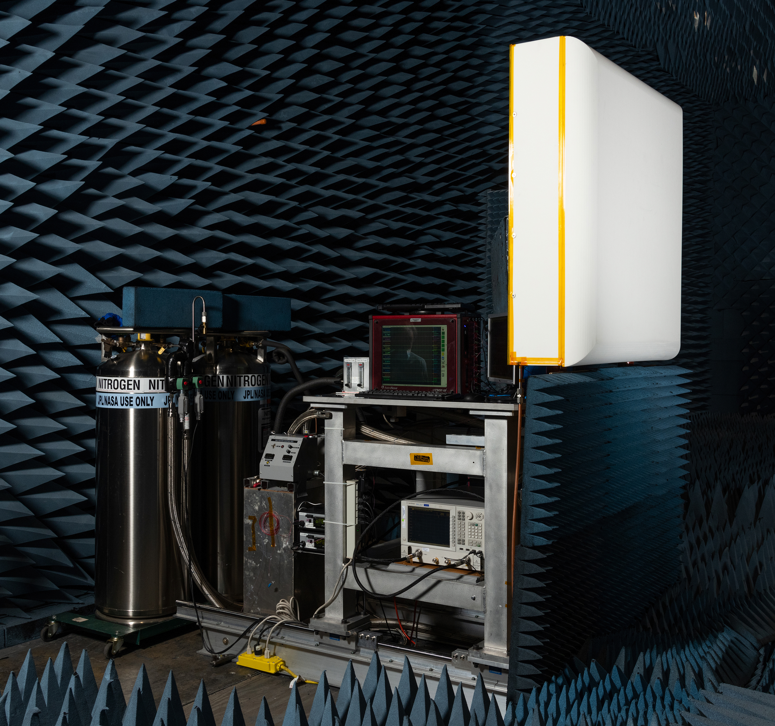 Photo of antenna in an anechoic chamber with the antenna in a white foam box.